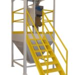 Surge bin with access stairs