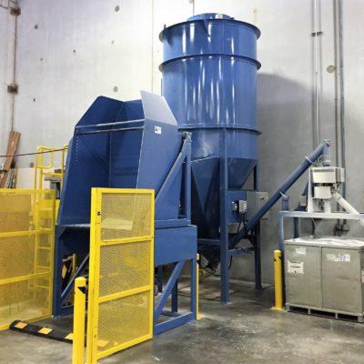 Vertical Auger mixer with dumper infeed and screw conveyor discharge